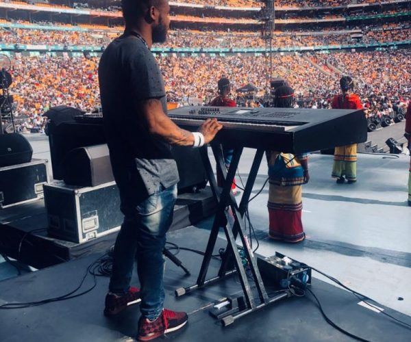 Wilson playing at the Global Citizen Concerts and Dbanj